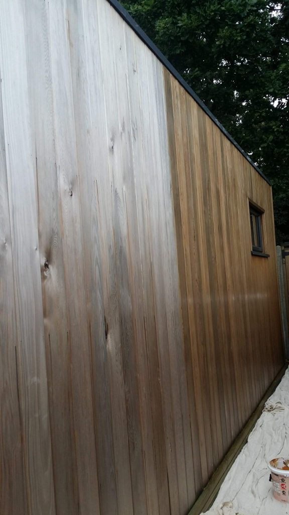 applying the first coat to the garden-room