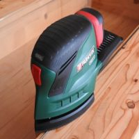 prepare woodwork with a palm sander